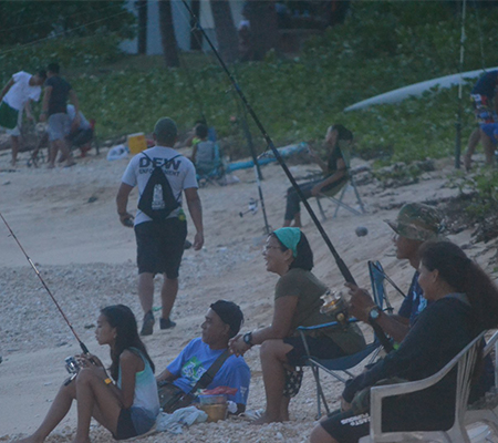 Youth and Families casting their fishing poles at Kammer Beach (Youth Fishing Derby)
